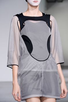 Dress with relaxed silhouette, cut outs & interlocking construction; sports luxe fashion details // Junya Watanabe