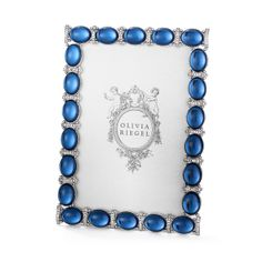 Hand-set Swarovski® crystals, silver-finished accents and cabochon sapphire faux gems add substantial sparkle to this Olivia Riegel frame collection.