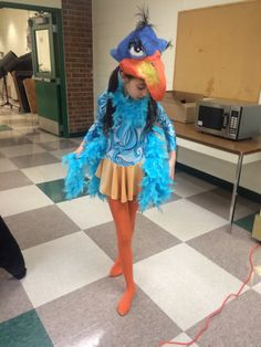My daughter as Zazu. I made the mask.