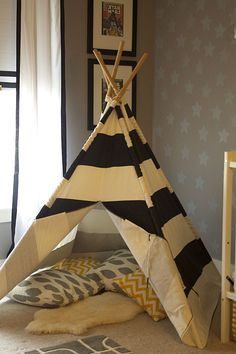 We adore this @Matty Chuah Land of Nod teepee in this transitional nursery. {The glider was removed and replaced with this!} #nursery #designtip