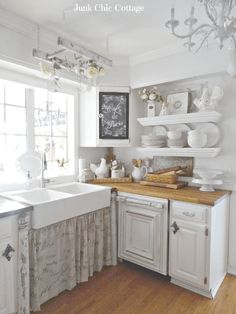 Distressed White Cabinets and Floating Shelves