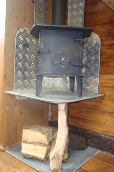raised wood stove in corner ... http://www.house-box.co.uk/gallery.html