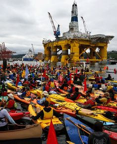 Hundreds of kayaktivists take to the water during a protest against drilling in the Arctic and the Port of Seattle being used as a port for the Shell Oil drilling rig Polar Pioneer. (Daniella Beccaria, AP)