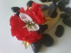 Red, white, black, and gold wrist corsage. Available at www.etsy.com/shop/deonanddionfashions