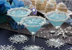 JACK FROST MARTINI  Makes 4 drinks Combine: 1 cup pineapple juice ½ cup (4 ounces) light rum or vodka ½ cup (4 ounces) blue curacao ½ cup (4 ounces) cream of coconut (not coconut milk) 10 to 12 ice cubes Mix together and strain into martini glass. Rim the glass with shredded coconut.