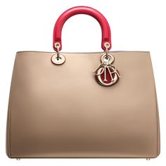 Smooth two-tone beige/crimson red leather 'Diorissimo' bag A true journey through the senses, an iconic line with timeless elegance embodying all the craftsmanship of Dior. The exquisite leather, two handle or shoulder strap options, and contrasting colours of the beige outer accentuated with crimson red handles and the Bombay blue inner make this 'Diorissimo' bag a unique model. Size: 38 cm x 27 cm x 12 cm - 'D.i.o.r' lettering in pale gold-tone metal. - 1 zipped pouch
