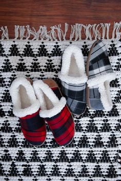 Cozy and cute. Stay warm by the fireplace and comfortable in these TOMS Slippers. Featuring red and black plaid or black and grey plaid and a faux shearling lining.