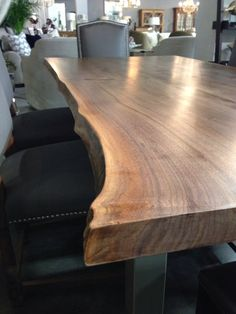These walnut slabs come from a local forest that was taken down. The trees are over 100 years old and have lots of amazing grain colours, lines and