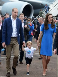 The trio happily walked among the crowds as they explored the incredible aircraft models. Catherine's dress without the navy jacket.