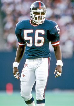 Lawrence Taylor Lawrence Taylor is a renowned NFL player for his perfect combination of size speed and strength. He was the pack leader of the Crazed Dogs group and said to be in attack-mode at all times. New York Giants Football, Nfl Football Players, Sport Football, Football Helmets, School Football, Sports Teams, Football Awards, Football Memorabilia, Bears Football