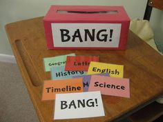 "Classical Conversations review game, ""Bang!""  Tissue box wrapped in duct tape, student pulls out a topic card, if they can say the memory work they keep the card.  (if not, put it back) If they pull out the ""bang"" card, they need to put back all the cards they've collected."
