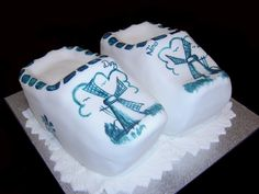 Dutch Clogs Cake - This was a combined birthday and anniverary cake for two Dutch people.  One Clog was Banana cake, the other was chocolate mud cake.  Images are handpainted from a picture I copied of a Delft Blue Clog.   Thanks for looking