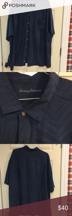 Tommy Bahama men's silk camp shirt PERFECT CONDITION Tommy Bahama men's 100% silk navy camp shirt. Short sleeves. Features front left chest pocket, and all over palm leaf texture Tommy Bahama Shirts Casual Button Down Shirts