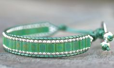 Stunning green square Miyuki beads woven with tiny sterling silver beads accenting between the metallic mint green leather cord.