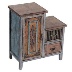 "Two-drawer distressed wood accent table.   Product: Accent tableConstruction Material: WoodColor: MultiFeatures: One door and two drawersDimensions: 25"" H x 22"" W x 12"" D"