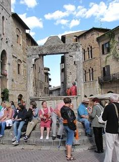@julie got married in San G.! Locals and visitors convene in one of San Gimignano's plazas.