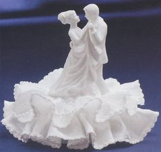 The dancing bride and groom wedding cake topper can be made from porcelain, glass, plastic, or from sugar or gum paste. Description from theweddingspecialists.net. I searched for this on bing.com/images