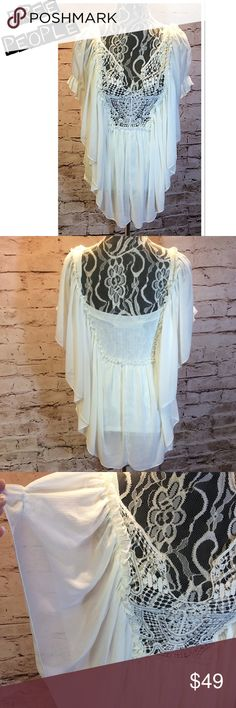PRECIOUS TOP BY FREE PEOPLE Spread your wings in this beauty. This is absolutely gorgeous. 65% rayon 35% nylon. It's a mixture of sheer and sweater knit material. The bodice is sweater knit and fitted to hug the body and the outer shell sheer and flowy. Gorgeous lace appliqué with metal studs along the neckline. Stunning cream color Free People Tops Blouses