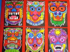 Chinese dragon masks. This paired/small group activity was done on A2 paper with oil pastel. Fold paper down the middle, draw features using sketching pencil, trace the other side so that symmetry is maintained. Encourage blending of colours that have the same base name.