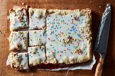 Ever since I saw the Crepes of Wrath's S'mores Pop-Tart slab pie, I just knew I had to make my own version of a Frosted Strawberry Pop-Tart! Can you think of anything more fun and delightful than a huge slab pie filled with jammy fresh strawberries, glazed, and topped with rainbow sprinkles? I didn't think so.