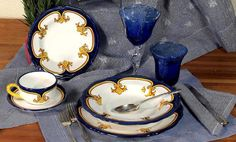 """Another elegant dinnerware design masterfully hand painted in Deruta, Italy,  featuring a fine and intricate design from the renaissance period featuring a regal yellow-gold Giglio (Lily) painstakingly countered by a royal blue solid color.    The ''Giglio'' (pronounced """"geel-yo""""), has been the symbol of the city of Florence (Firenze) since its foundation in 1000 B.C. and it is not a lily at all, it's an Iris - or Giaggiolo."""
