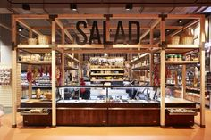 """Much of the design input was directed in creating the 'urban market', making it the heart of the store and main service node. This was anchored by a """"wine cellar"""" to direct the shopper through the store into this market space."""