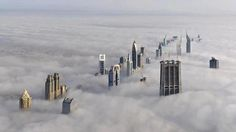 This photo was taken from Burj Khalifa in Dubai, the highest building in the World, showing a magnificent layer of fog covering most of the city