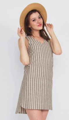 Pin Down Dress sleeveless strip shift dress with a V neckline and cutout on the back. Perfect for a picnic weather!