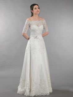 Lace wedding dress with off shoulder bolero by ELDesignStudio