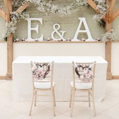 What a lovely idea for when you sign the wedding register  Decorate the chairs and add your own personal letters  Photo Credit // Dasha Caffrey
