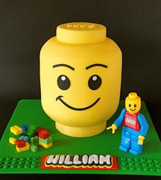 I made this for my son Williams' 9th birthday. He just loves Lego and so I thought it would be fun to make him a Lego themed cake! The cake is carved from 2 × 6 inch round white chocolate mud cakes with dark chocolate ganache filling and crumb...