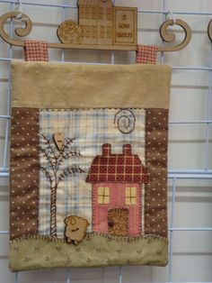 Wall hanging with cottage