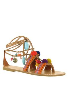 3eba9e5f3e0 The MIA Renata leg wrap sandal is decorated with playful pom-poms and  artisanal embellishments. This faux leather