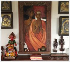 beautiful vignettes, parapachi bommai, tanjore paintings and art framed in an old wooden door frame