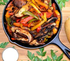 Vegan Fajitas Recipe Main Dishes with chili powder, black pepper, salt, sugar, paprika, onion powder, garlic powder, cumin, red pepper flakes, portabello mushroom, orange bell pepper, purple onion, oil, tortillas, guacamole, vegan sour cream, salsa