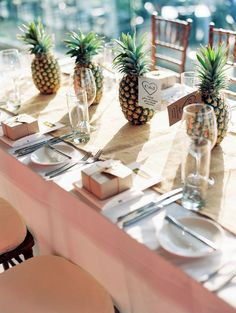 Pineapple Centerpieces - simple (and edible!) then maybe add some fresh flowers in cans in between and shells