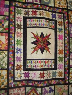 I am not sure what the center block is quilt block is called but I really like the star effect it gives.
