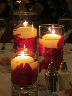 Floating candles, red rose petals.