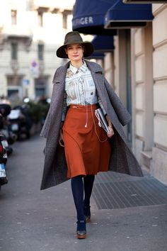 hat, button down, skirt, tights.