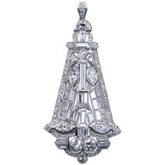 Art Deco Fancy Shapes Diamond Kite Shaped Pendant. A fabulous diamond in platinum pendant from the Art Deco period contains approximately ten carats of fancy and calibrated cut diamonds. Includes two old European cuts of 1.0 carats total weight and four marquise shapes of 2.00 carats total weight.