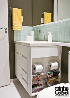 Bathroom built-in storage for toilet paper and magazines