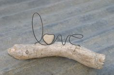 LOVE wire word and heart stone on driftwood sculpture Holiday gift or Wedding. $28.00, via Etsy.