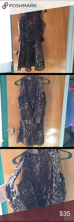 """Sleeveless Dress Leopard, size Medium. Sleeveless and also backless. Features a high neck that buttons on the back as well as a """"cape like"""" feature on the back as seen in the pictures. Fitted around waist. Love this but can't pull off the backless. Dresses Backless"""