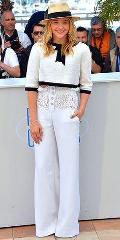 at the film festival in the south of France …     CHLOË GRACE MORETZ No, this isn't a Venetian gondolier, it's just the young actress all dressed up in enviable head-to-toe Chanel for the Clouds of Sils Maria photo call.