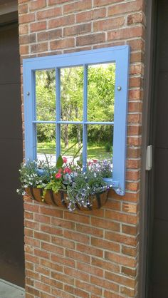 Salvaged old wooden window sash turned into mirror with added flower box.