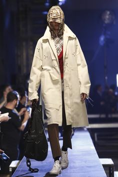 The grim reaper madras hoodies worn by the male models on the raised Raf Simons catwalk definitely produced the desired effect. They obscured the models faces while they walked fast, and in packs, ...