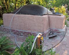 Building the Biodigester. Materials will cost $1,000 to $1,200, depending on the price of ready-mix concrete in your area