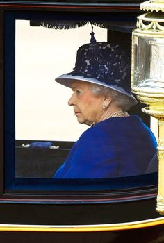 LONDON, ENGLAND - JUNE 15:  Queen Elizabeth II rides in a carriage during the annual Trooping the Colour ceremony at the Horse Guards Parade on June 15, 2013 in London, England.