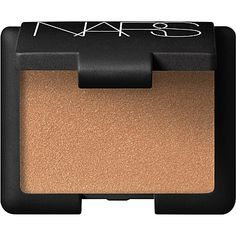Silver tones can look harsh against black skin so go for something warmer. Opt for one with a golden shimmer, like this NARS eyeshadow, which brightens the complexion. (Cream Eyeshadow in El Dorado, £18, NARS at Selfridges)