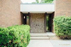 mid-century modern in Holladay, Utah, bark paneled door, brick exterior